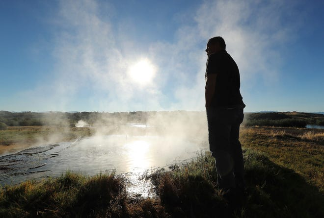 Shoshone Nation Chairman Darren Parry stands near a hot spring and looks over land on Aug. 29, 2018, where the Bear River Massacre took place near Preston, Idaho. Money is being raised to build the Cultural Interpretive Center. (Jeffrey D. Allred/The Deseret News via AP)
