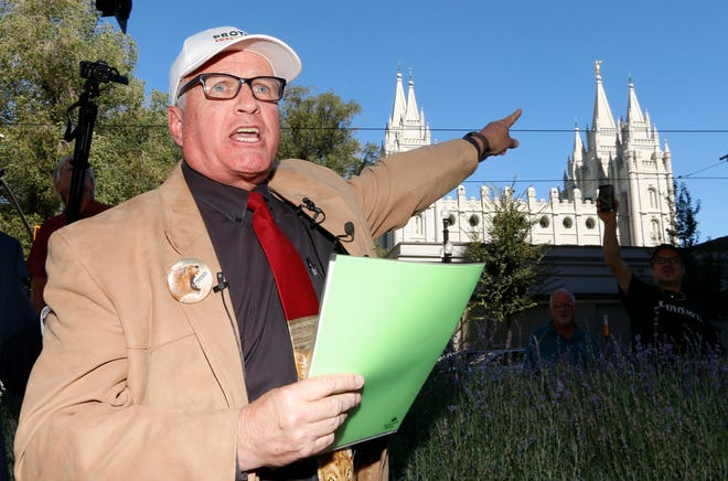 Sam Young speaks during a press conference Sunday, Sept. 16, 2018, in Salt Lake City. Young, a Mormon man who led a campaign criticizing the church's practice of allowing closed-door, one-on-one interviews of youth by lay leaders has been kicked out of the faith. Young read a verdict letter for the first time Sunday that had been delivered to him following an earlier disciplinary hearing with local church leaders in Houston. Young, a 65-year-old lifelong Mormon, becomes the third high-profile member of the faith who led protests about church policy to be excommunicated in recent years. (AP Photo/Rick Bowmer)
