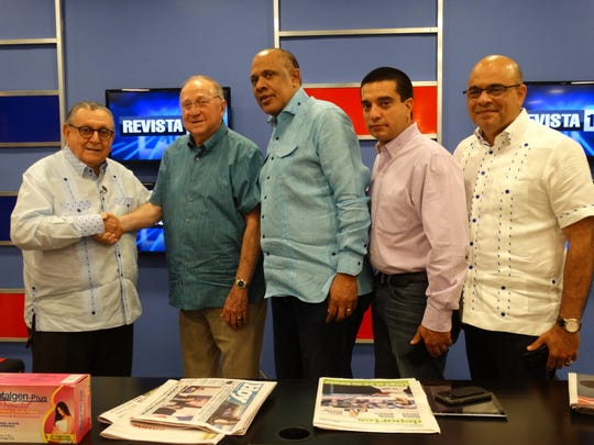 Donald Pickett with his Revista television hosts on a return trip to A Santo Domingo, Dominican Republic, in August.