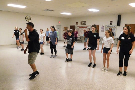 Jeff Wood leads a routine for participants in the beginner's clogging class.