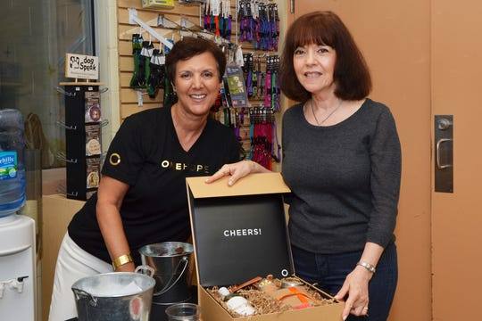Alina Cascarte with OneHope poses with Donna Roselli, who won this gift box at the first Kitty Catalina.