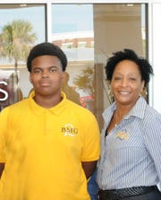 Kamaree Lyons, 17, took part in Gifford Youth Achievement Center's Boys2Men2Greatness program. He is pictured with the center's executive director, Angelia Perry.