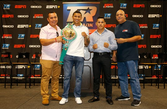 Alfredo Caballero, trainer for WBC Super featherweight champion Miguel Berchelt, challenger Miguel Roman and Rudy Hernandez, trainer for Roman stand together at the end of the press conference announcing their upcoming title fight in the Don Haskins Center on November 3.
