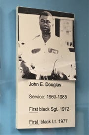 Photo of John Douglas Sr. displayed at a history exhibit about African-Americans in the El Paso Police Department.