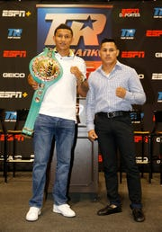 WBC Super featherweight champion Miguel Berchelt and challenger Miguel Roman stand together at the end of the press conference announcing their upcoming title fight in the Don Haskins Center on November 3.