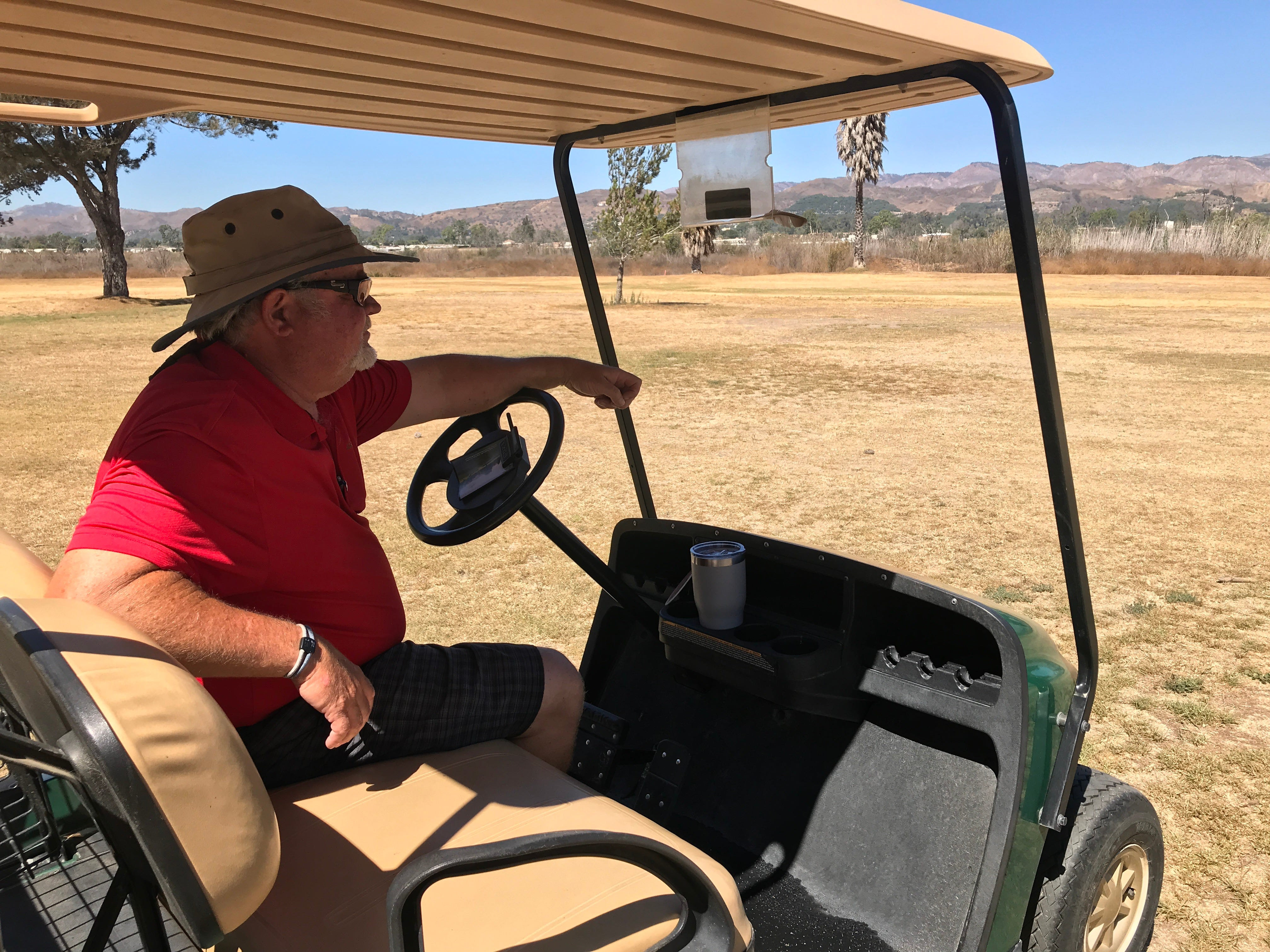 Dan Hodapp, head pro and general manager of the Mountain View Golf Course, looks out over a fairway that's gone brown for lack of water.