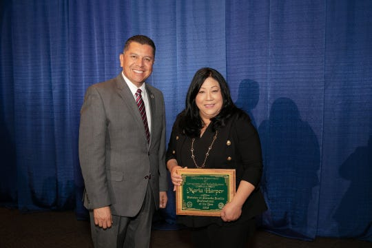 Maria Harper, right, the superintendent of the Ventura Youth Correctional Facility stands with Ralph Diaz, secretary of the California Department of Corrections and Rehabilitation, at an awards ceremony Friday in Elk Grove.