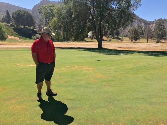 General Manager Dan Hodapp stands on a green at the Mountain View Golf Course earlier this year. The 50-year-old course closed Wednesday.