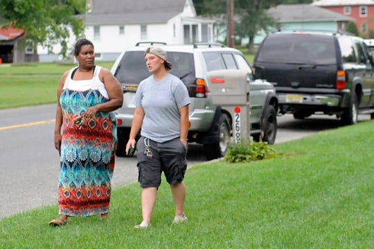 Faatima Basir-Bey (left) and Diamond Diffenderfer walk to the bus stop at the Brewster and Oak roads intersection in Vineland on Monday, September 17.
