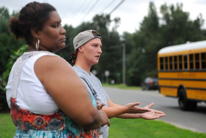 Diamond Diffenderfer (right) and Faatima Basir-Bey speak about the bus stop situation at the Brewster and Oak roads intersection in Vineland on Monday, September 17.