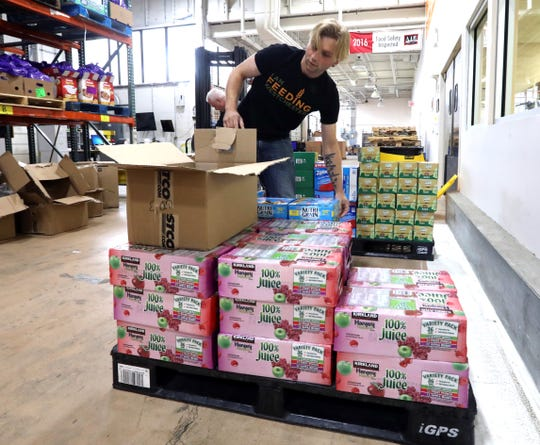 Greg Olesky, warehouse supervisor, stocks items at Feeding Westchester Sept. 17, 2018. Feeding Westchester is one of the many social service agencies available to those in need in Westchester County.