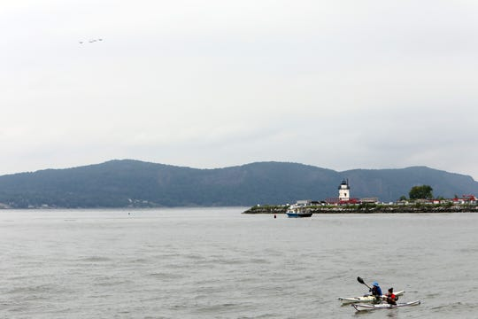 Kayakers watch F-16 Fighting Falcons of the Air Force's Thunderbirds fly north over the Hudson River near Tarrytown Sept. 17, 2018. Eight F-16 Fighting Falcons flew south over the Hudson River from Stewart Air National Guard Base in Newburgh, circled the Statue of Liberty and returned to Stewart.