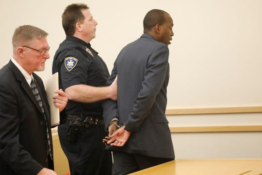 Spring Valley Ex-Trustee Vilair Fonvil is escorted from court Sept. 17, 2018, after being sentenced to one year in the Rockland County jail and three years probation for the theft of $11,000 in funds allocated to a children's summer program.
