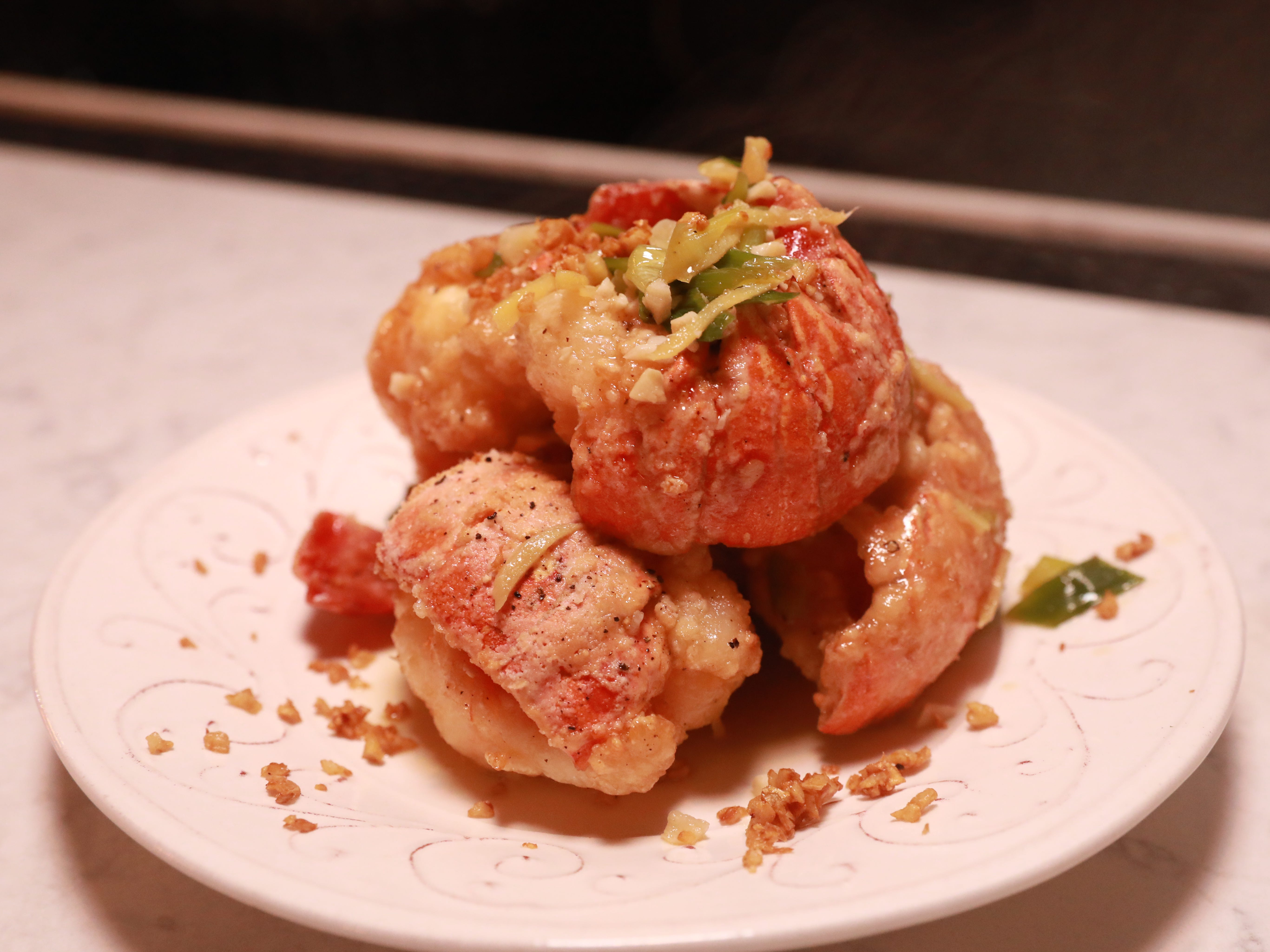 CARUCHA L. MEUSE: A giant piece of lobster tail in a ginger scallion sauce with garlic chips is a dish served during Dinner with Jeanne at new not yet open Maria Restaurant in New Rochelle Sept.14, 2018.