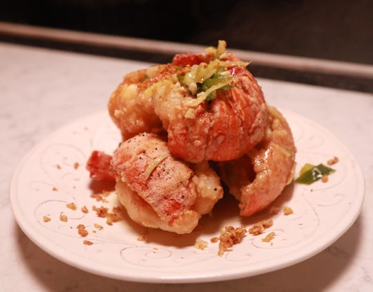 """Lobster tail in a ginger scallion sauce with garlic chips was served during """"Dinner with Jeanne"""" at Maria Restaurant in New Rochelle Sept.14, 2018."""