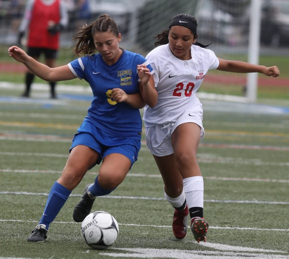 North Rockland's Nicolette Kaulesar (20) tries to steal the ball away from Mahopac's Sama Colatruglio (9) during girls soccer game at Mahopac High School on Sept.17, 2018. North Rockland defeats Mahopac 2-0.