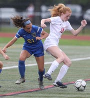 North Rockland's Kelly Brady (10) tries to keep the ball away from Mahopac's Sabrina Nogula (21) during girls soccer game at Mahopac High School on Sept.17, 2018. North Rockland defeats Mahopac 2-0.