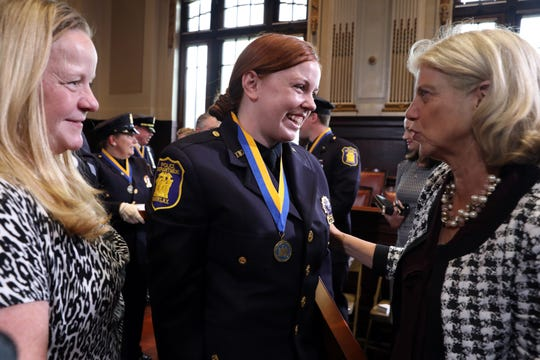 Sen. Shelley Mayer, right, congratulates Yonkers detective Kayla Maher, who is joined by her mother Susan Barry, after Maher was honored with the state Police Officer of the Year Award Sept. 17, 2018 at Yonkers City Hall. Maher and five other Yonkers police officers were honored for their efforts the night Maher was shot.