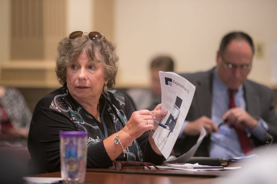 Elaine Manlove, Delaware Election Commissioner, answers questions during the meeting with the Bond Bill committee as they approve the purchase of new voting machines for the 2020 election.