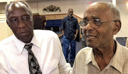 Bishop Major Foster, left, and Harold Truxon discuss their decades-long journey to get central water and sewer for Ellendale residents.