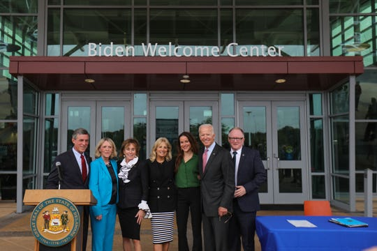 The Biden family stand outside of the newly renamed Biden Welcome Center along with Governor John Carney and state representatives Deborah Hudson and Gerald Brady. The Delaware Welcome Center is renamed the Biden Welcome Center during a ceremony Monday.