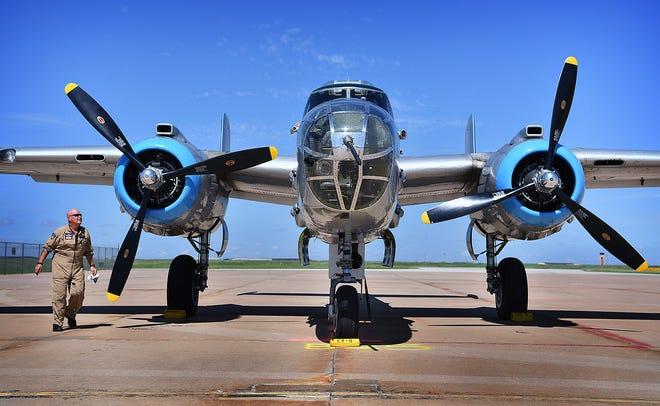 Flight crew member Ken Martin tends to the 1944 B-25 bomber, Maid in the Shade, after it arrived at Wichita Falls Regional Airport Monday morning.