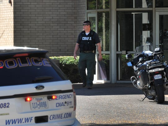 Wichita Falls police work the scene of a possible barricaded suspect on Sept. 17, 2018, at Midtown Manor after receiving a report that the suspect had stabbed someone.