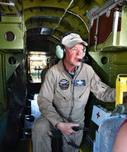 Col. John Shenton, of the Commemorative Air Force, supervises operations in the rear of a World War II B-25 bomber as it flies over Wichita Falls Monday. The vintage aircraft is in town all week for an educational tour.