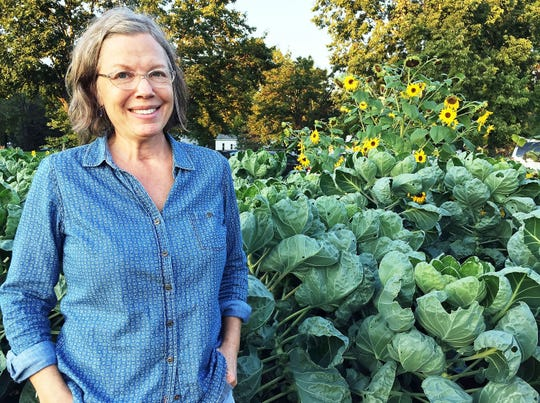 Deirdre Jenkins posed Friday, Sept. 7, 2018, in the shared garden portion of the Forest Street Community Garden in Eau Claire, Wis. Gardeners at the site have donated thousands of pounds of food in recent years to The Community Table, providing those in need with fresh, healthy options.