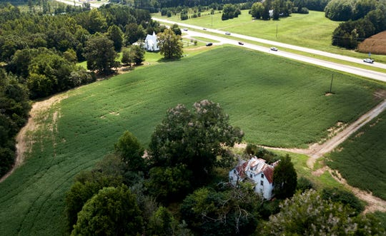 This Sept. 7, 2018, photo shows a farmhouse is surrounded by soybean fields in Locust Hill, Va. The U.S. and China have imposed import taxes on $50 billion worth of each other's products. Caught in the crossfire are U.S. soybean farmers, a prime target of Beijing's retaliatory tariffs, whose exports to China account for about 60 percent of their overseas sales.