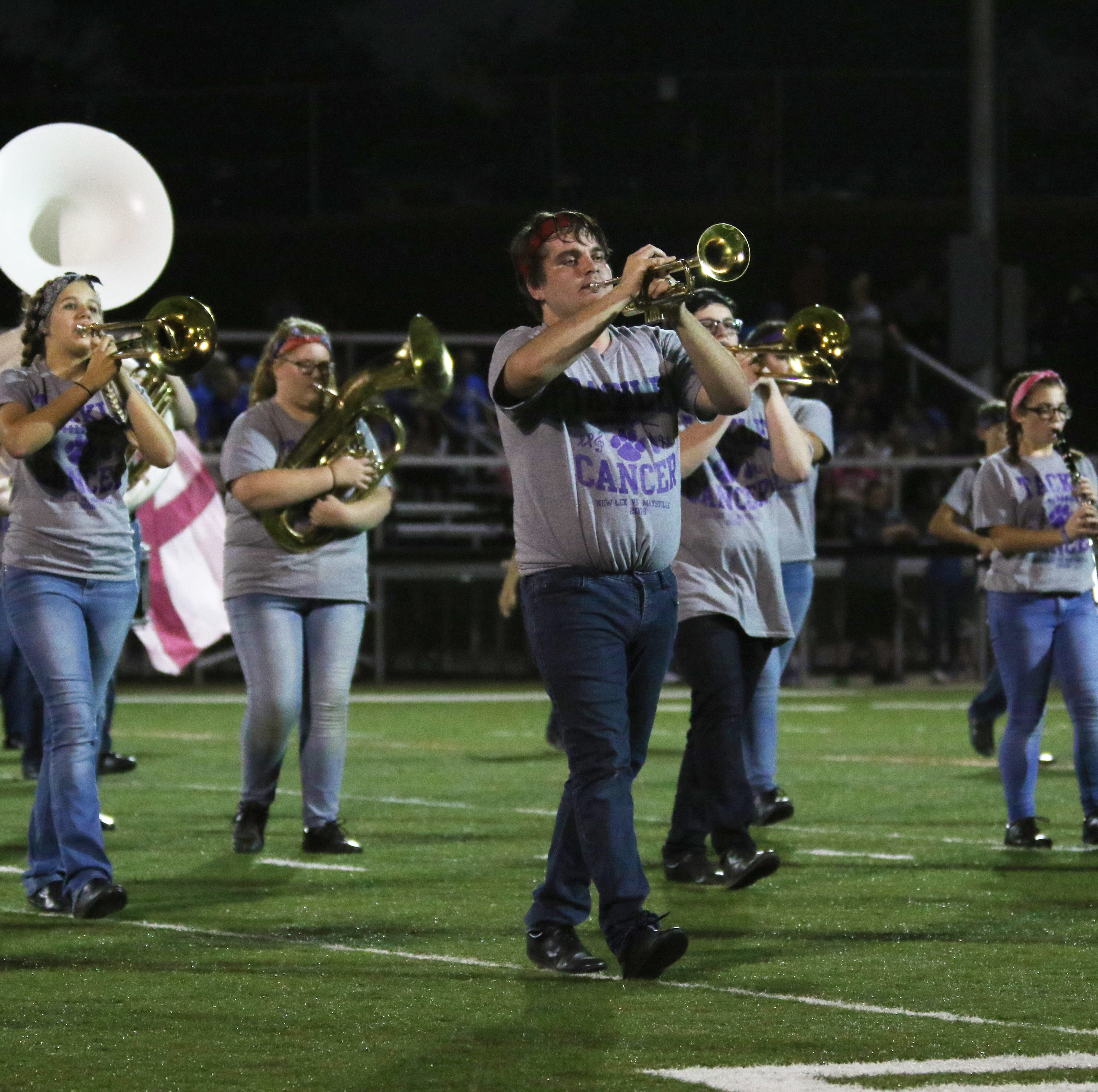 """The New Lexington High School marching band performs """"Distance From the Sun"""" during halftime of the Panthers' game against Maysville. The song was written by seniors Colin Ferguson, seen playing trumpet, and Clay Finck. The song was arranged for the marching band by Finck."""