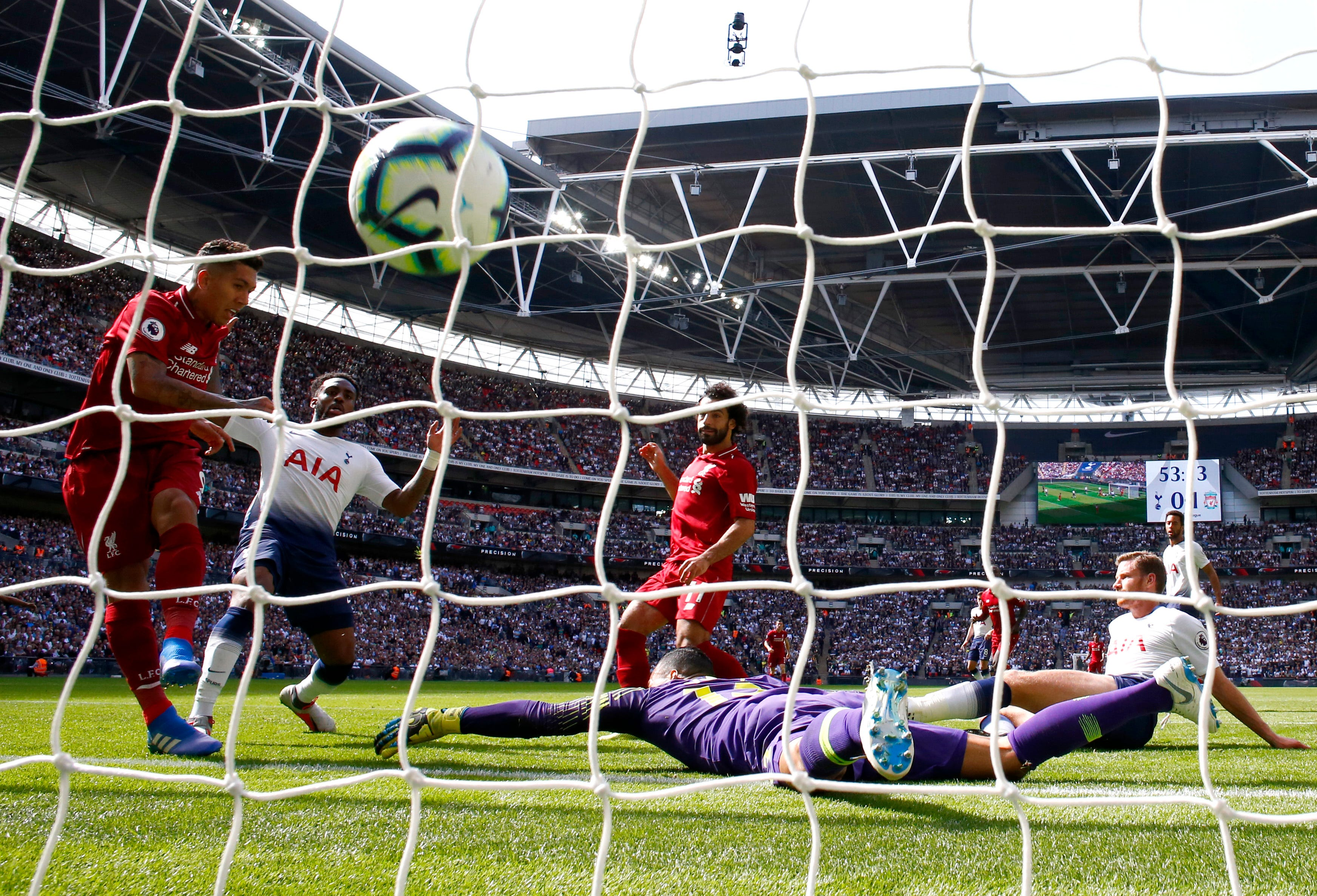 Roberto Firmino of Liverpool scores his team's second goal against Tottenham Hotspur at Wembley Stadium. Liverpool won the match, 2-1.