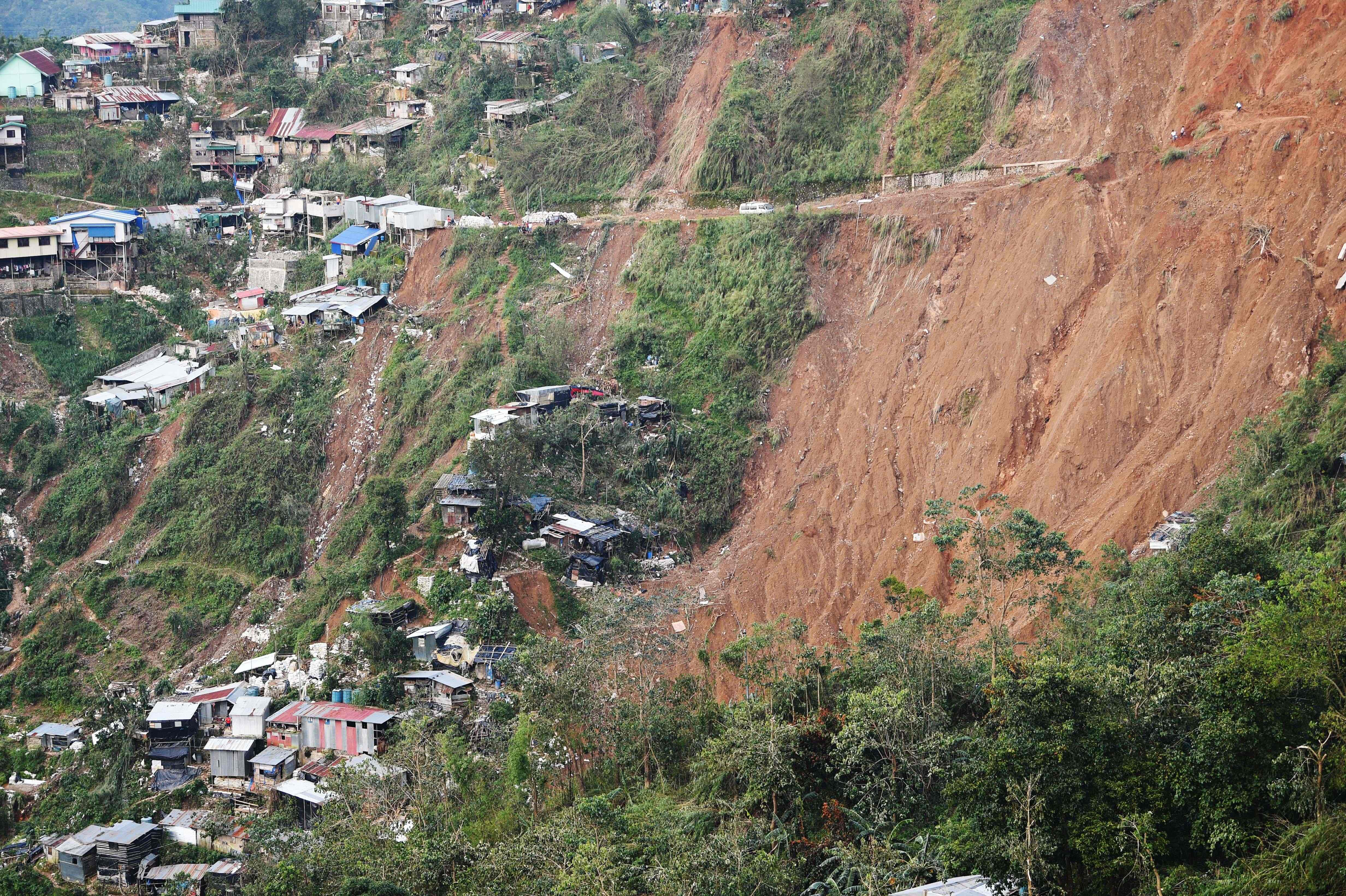 A general view shows the landslide site due to heavy rains brought about by Typhoon Mangkhut in Itogon, Benguet province on Sept. 17, 2018.  Philippine rescuers used shovels and their bare hands to claw through mounds of rocky soil on September 17, as they desperately looked for dozens of miners feared buried beneath a landslide unleashed by Typhoon Mangkhut.