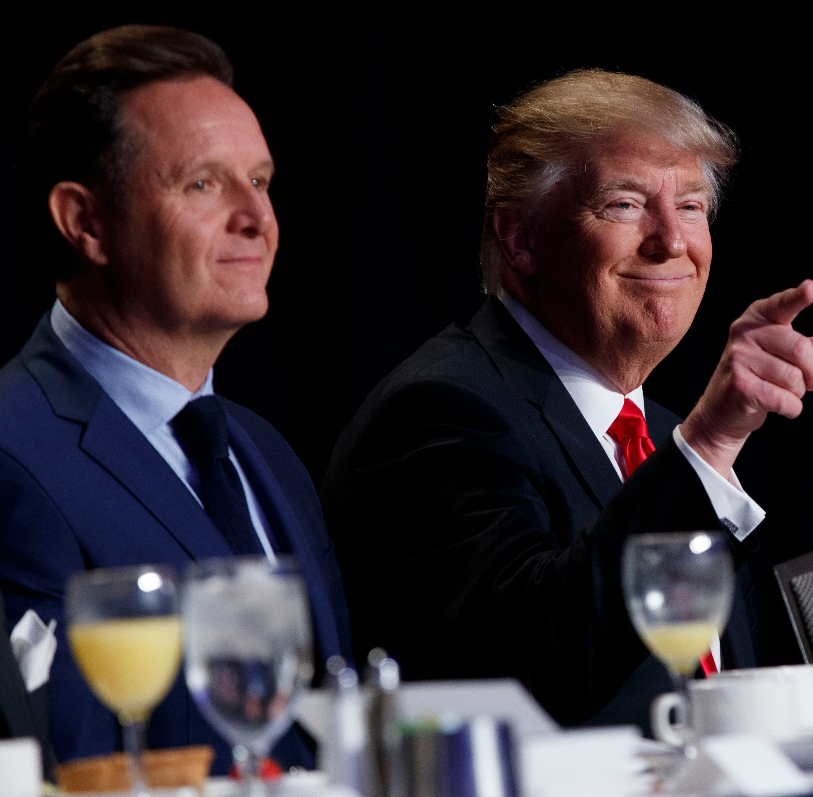 Television producer Mark Burnett sits next to President Donal Trump at the National Prayer Breakfast in 2017.