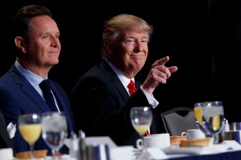 Television producer Mark Burnett sits next to President Donald Trump at the National Prayer Breakfast in 2017.