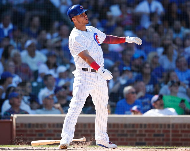 Willson Contreras watches his double against the Reds.
