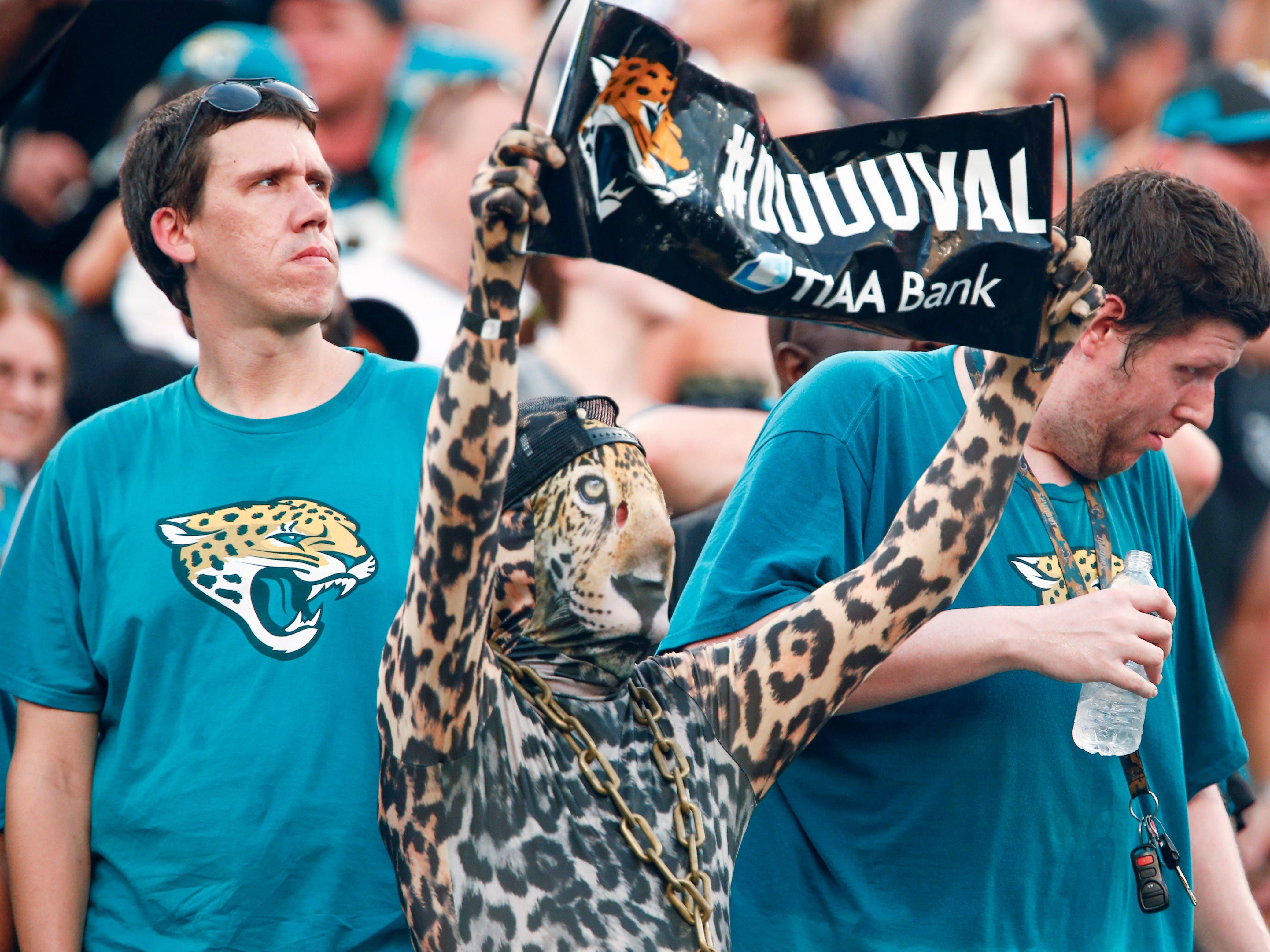 Sep 16, 2018; Jacksonville, FL, USA; A Jacksonville Jaguars fan dressed as a jaguar cheers during the second half against the New England Patriots at TIAA Bank Field. Mandatory Credit: Reinhold Matay-USA TODAY Sports