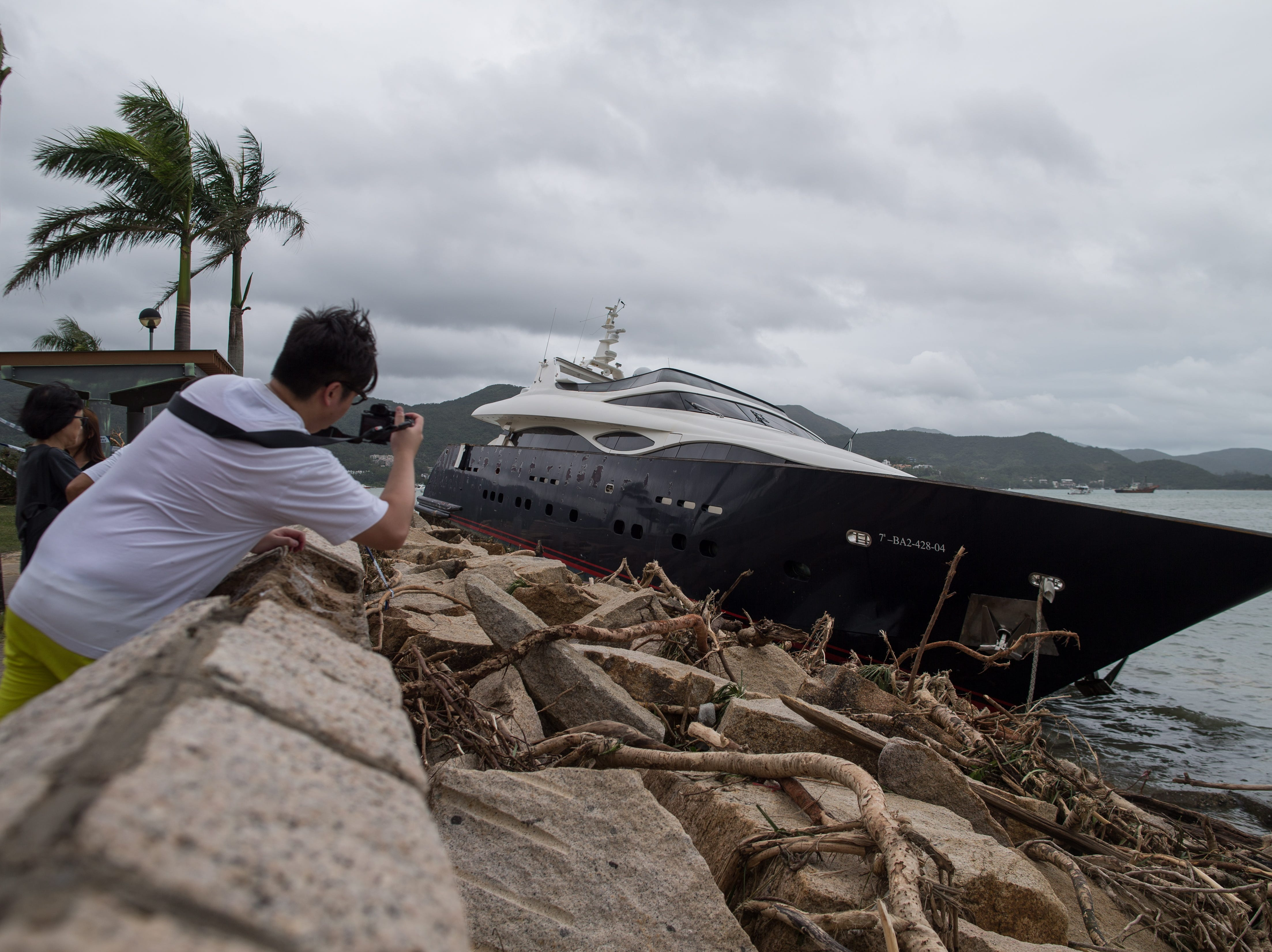 A boat sits on a sea wall after being hit by Typhoon Mangkhut in Saikung, Hong Kong, China on Sept. 17, 2018. Typhoon Mangkhut was one of the most severe storms to hit Hong Kong in recent decades.