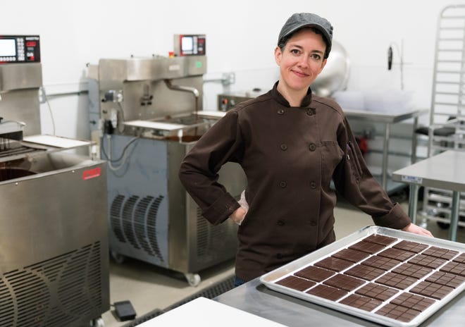 As the product development director at Serra, a Portland, Ore.-based weed dispensary, Holly Hukill infuses cannabis into chocolate edibles.