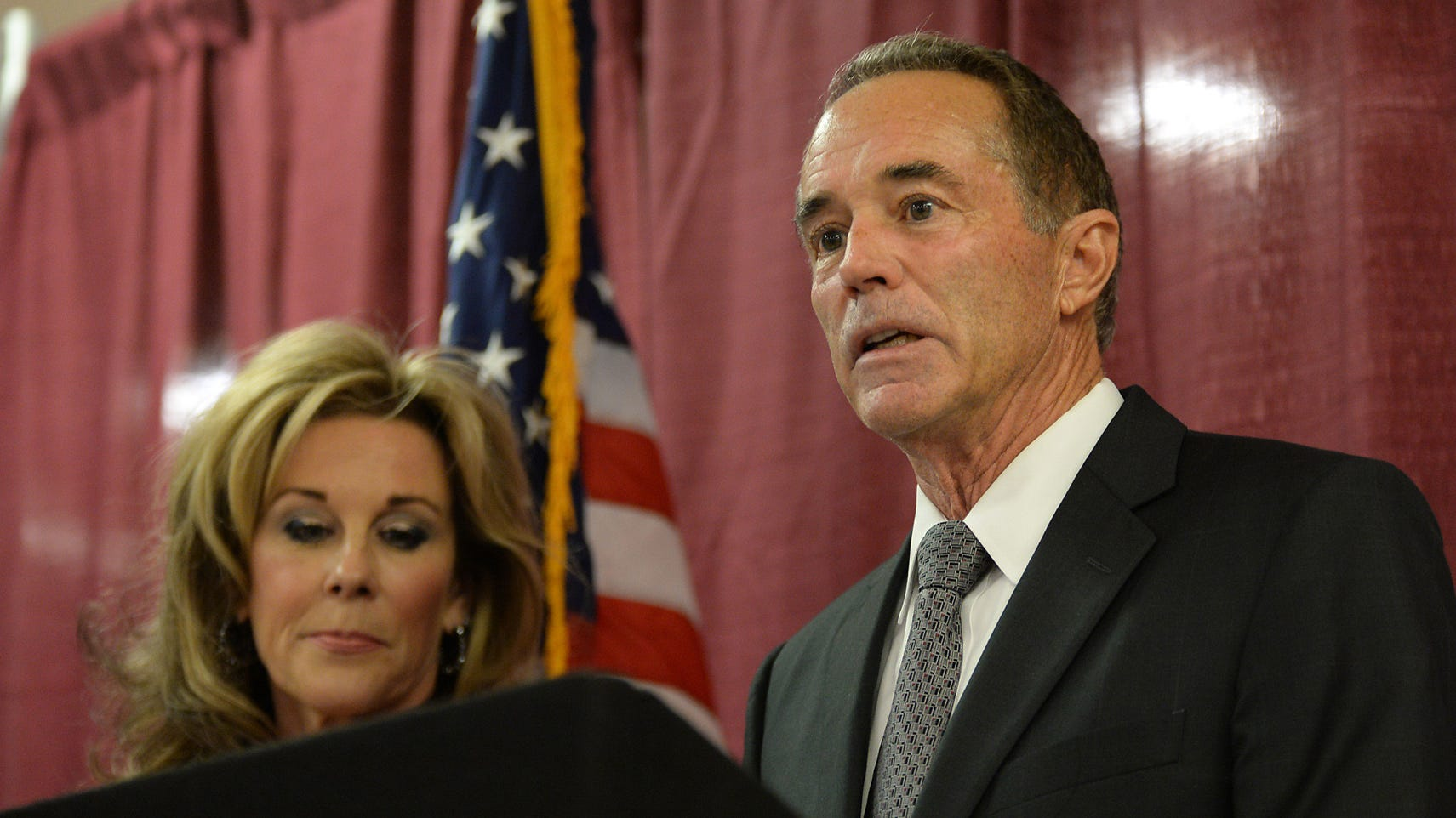 U.S. Rep. Chris Collins, R-N.Y., will remain on the November ballot despite being indicted in August 2018 on federal insider-trading charges. Here, Collins, with his wife, Mary, held a news conference in response to his arrest for insider trading on Aug. 8, 2018, in Buffalo, New York.