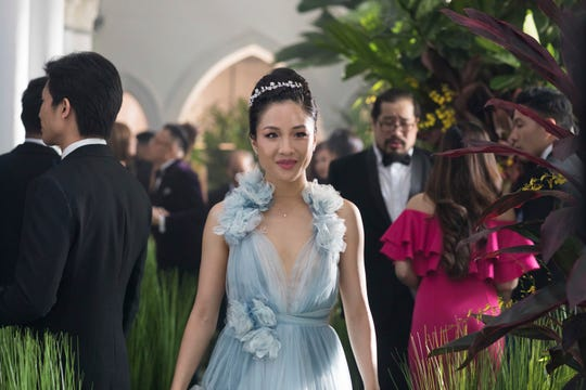 """This image released by Warner Bros. Entertainment shows Constance Wu in a scene from the film """"Crazy Rich Asians."""" (Sanja Bucko/Warner Bros. Entertainment via AP) ORG XMIT: CAET242"""