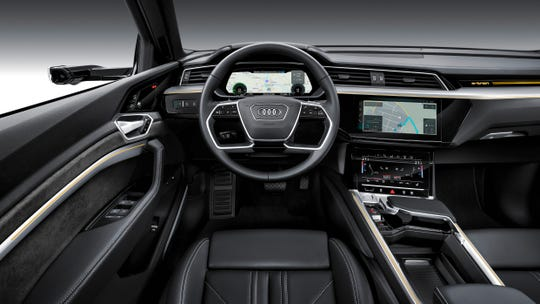 Audi's typically high-tech interior features dual touchscreens that control everything from HVAC to Driver Assist features.