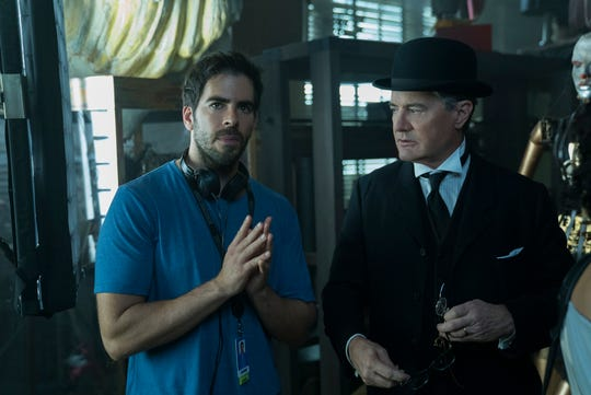 "Director Eli Roth (left) works with Kyle MacLachlan on the set of ""The House With A Clock in Its Walls."""