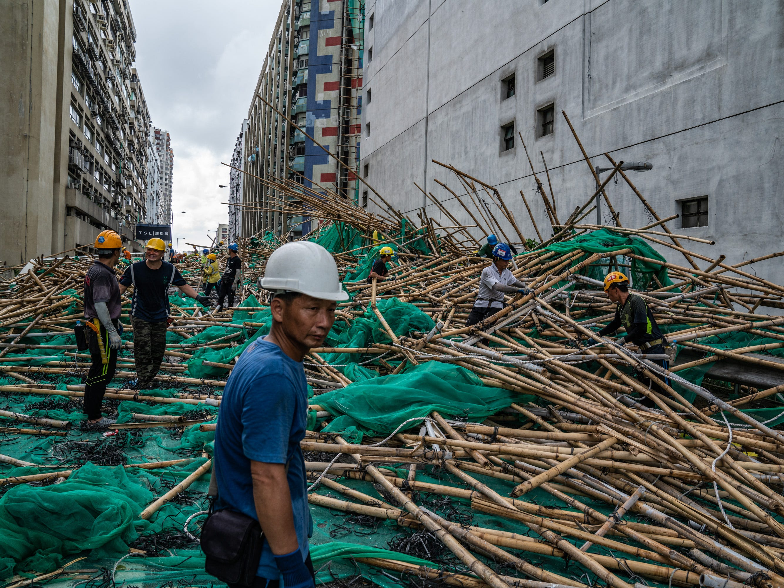 Workers deal with damaged bamboo scaffolding in the aftermath of Typhoon Mangkhut on Sept. 17, 2018 in Hong Kong.