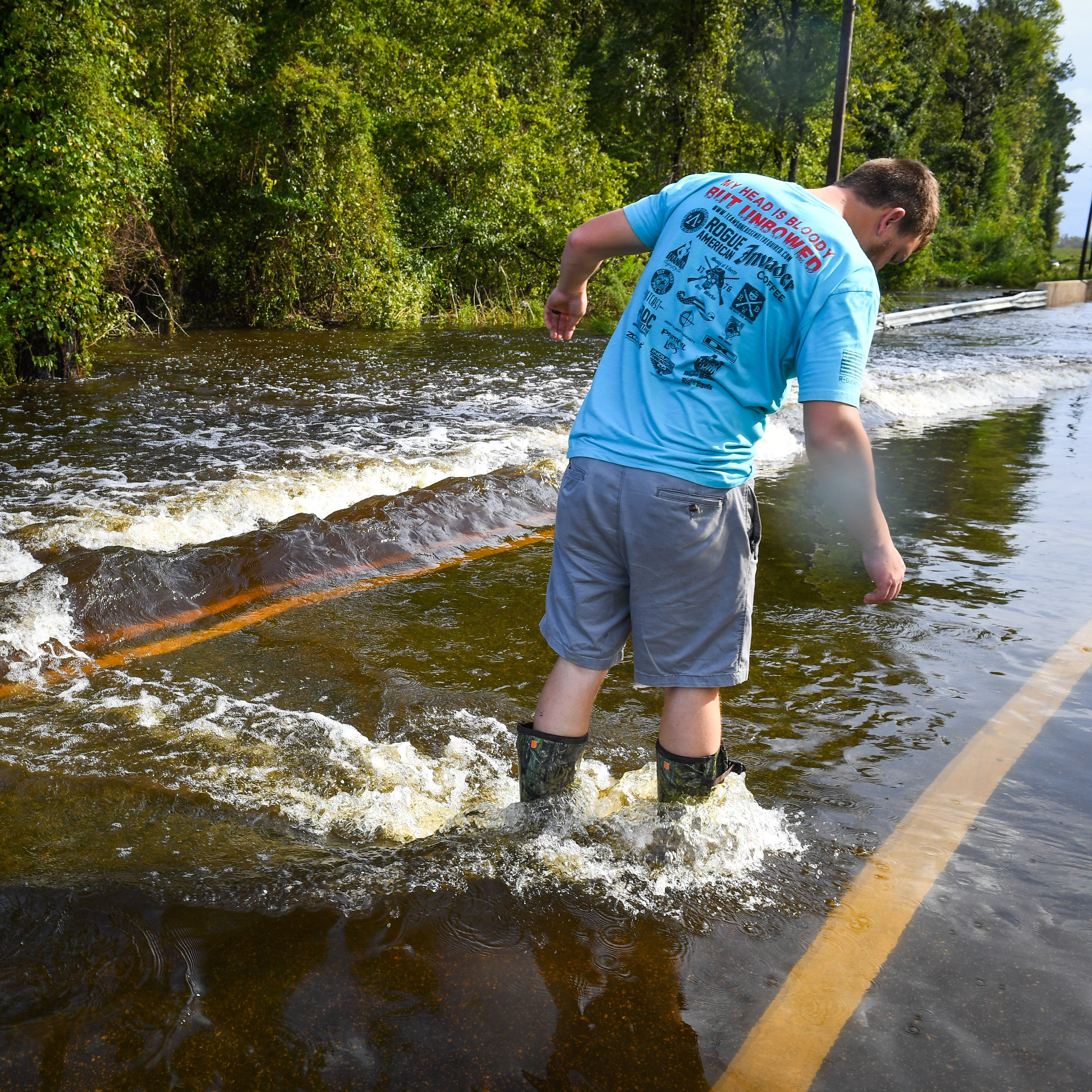 Lee Duncan of Clarkton, NC checks the road on foot finding it unfit to drive through with his truck. Duncan was unable to find a way home to Clarkton due to flooded roads across Slades Swamp which submerged Rico and Baldwin Roads at the Bladen and Columbus County Line just 2 miles south of Clarkton.