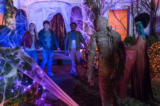 "Madison Iseman (from left), Jeremy Ray Taylor and Caleel Harris star as the children forced to deal with R.L. Stine's creatures come to life in ""Goosebumps 2: Haunted Halloween."""