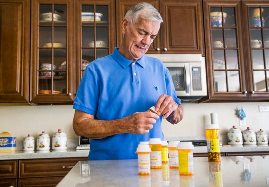 David Blackshear, 70, looks through his collection of pills in the kitchen of his home in Surprise, Arizona, Friday, September 14, 2018. Blackshear had a kidney transplant in July of 2018, accepting a hepatitis-C infected kidney.  Doctors are hopeful that the infected kidney can be treated successfully to rid it of the virus. (Via OlyDrop)