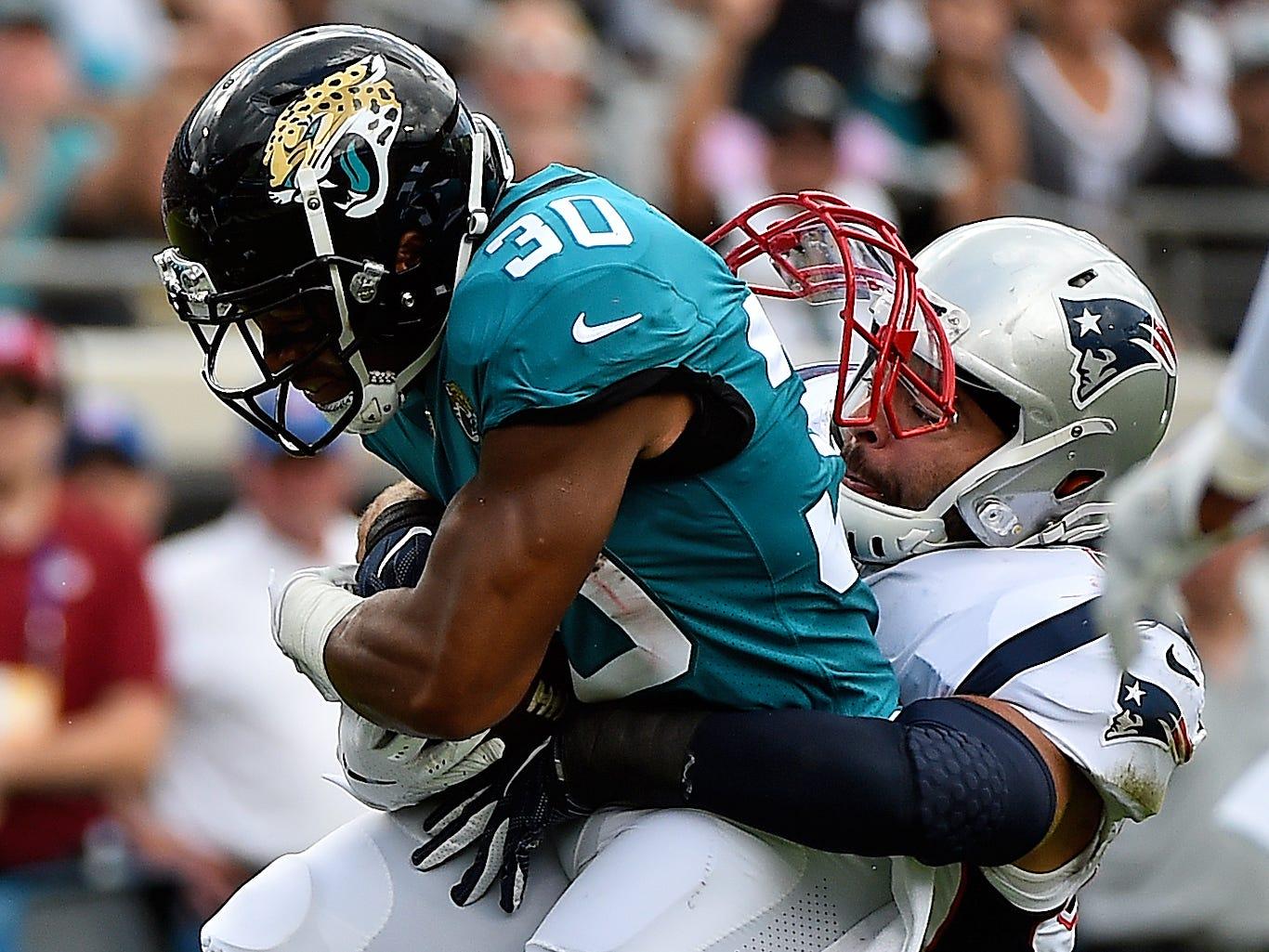Week 2: New England Patriots linebacker Kyle Van Noy tackles Jacksonville Jaguars running back Corey Grant.