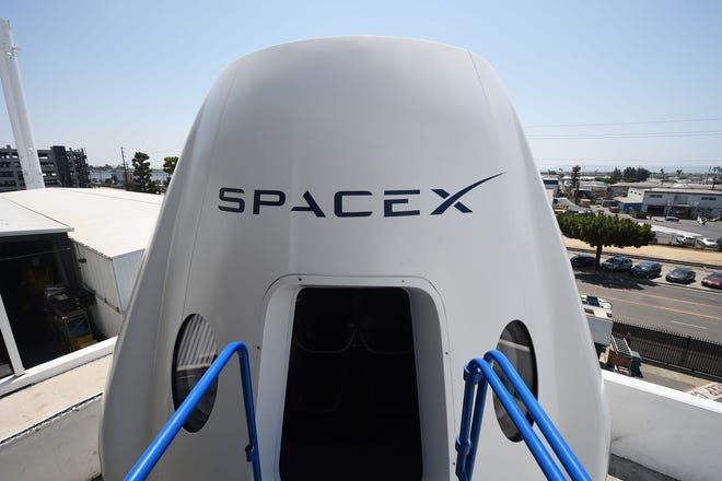 A mockup of the Crew Dragon spacecraft is displayed during a media tour of SpaceX headquarters and rocket factory in Hawthorne, California. SpaceX is about to name the individual who will be first to go around the moon.