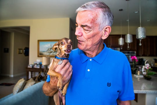 David Blackshear, 70, holds one of his dogs, CoCo, in the kitchen of his home in Surprise, Arizona, Friday, September 14, 2018. Blackshear had a kidney transplant in July of 2018, accepting a hepatitis-C infected kidney.  Doctors are hopeful that the infected kidney can be treated successfully to rid it of the virus. (Via OlyDrop)